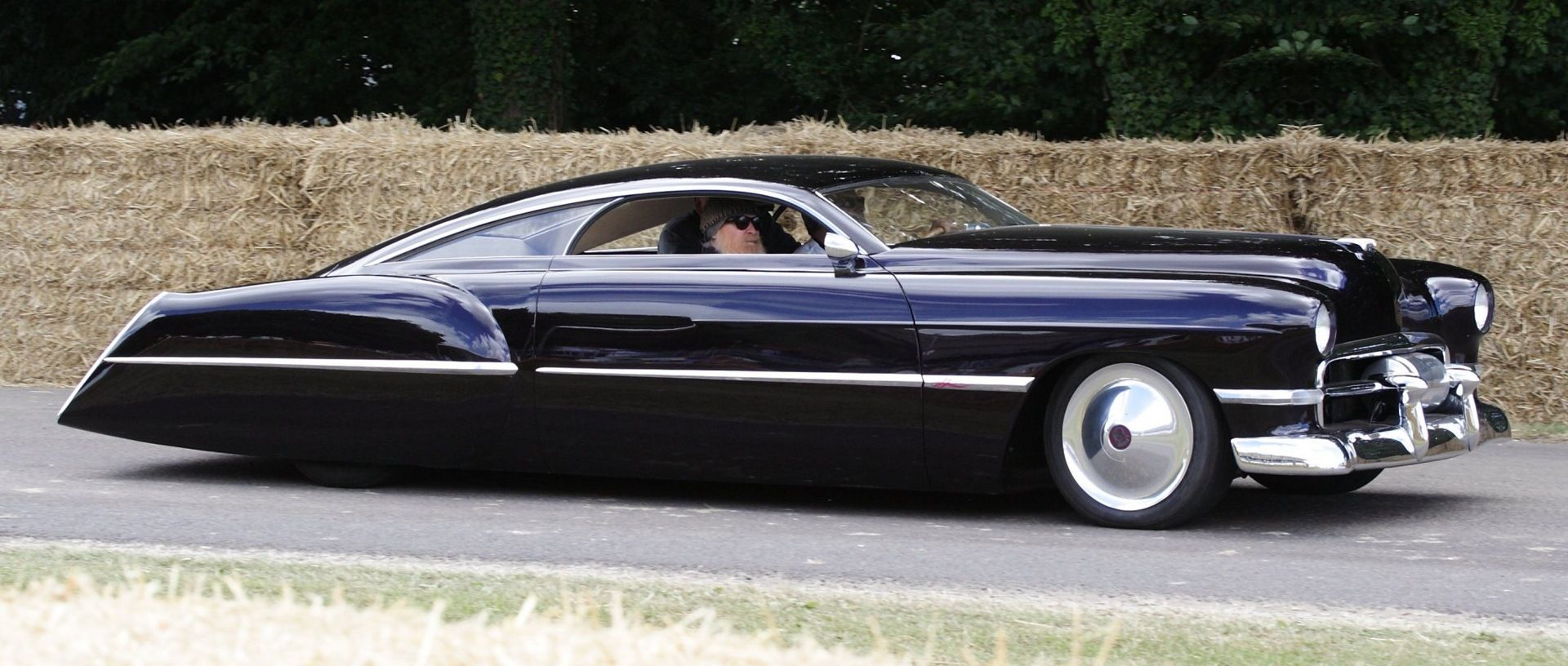 The base car is a 1948 Cadillac Series 62 Sedanette, customized for
