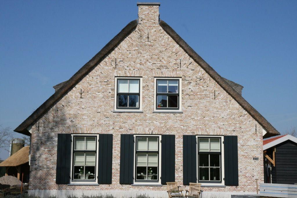Realisatie woning opgetrokken uit antieke ijsselstenen for Landelijke stijl interieur