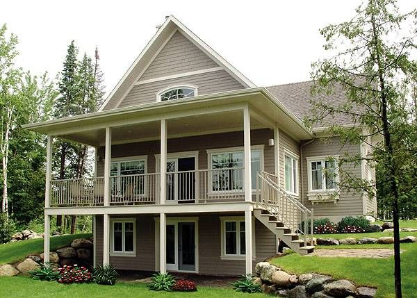 Featured House Plan Bhg 1143 Sloping Lot House Plan Basement House Plans Cottage House Plans
