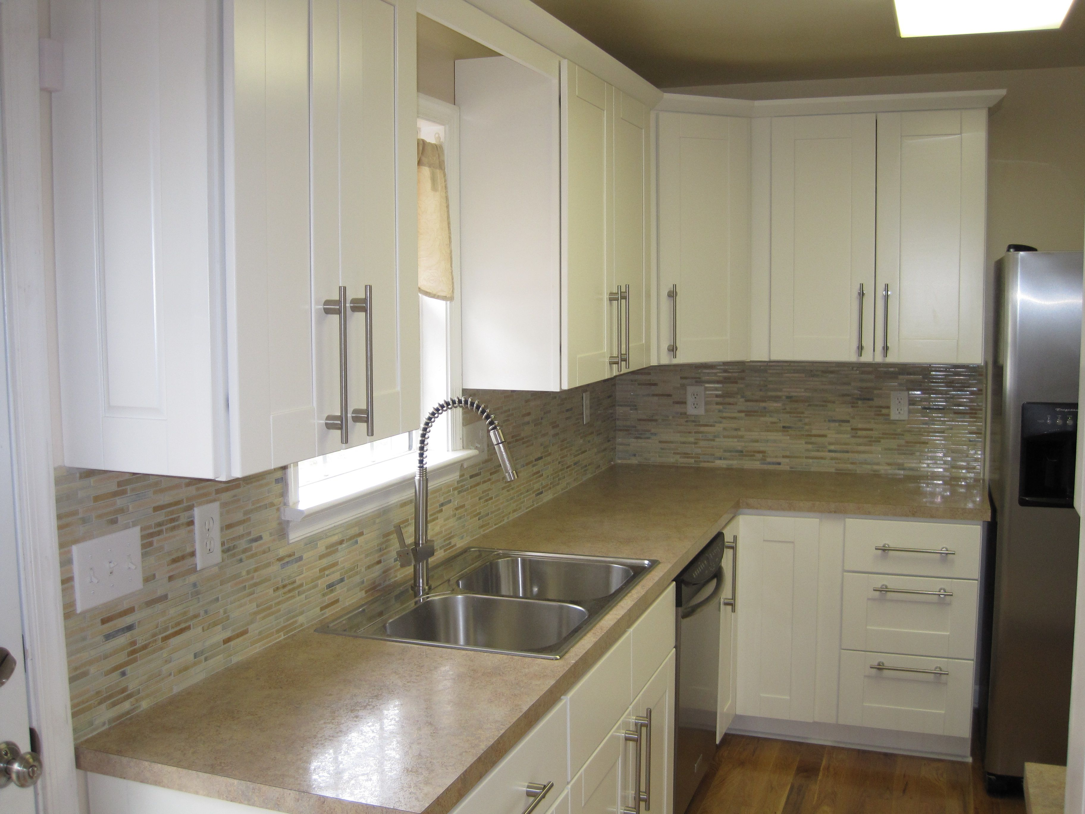 tan beige laminate counters w matching mosaic backsplash Kitchen Remodeling Portfolio by Handyman Connection