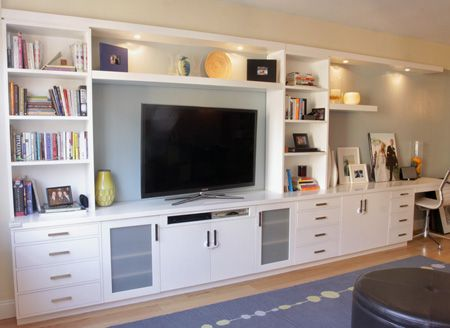 the living room was in need of a great deal of storage as well as