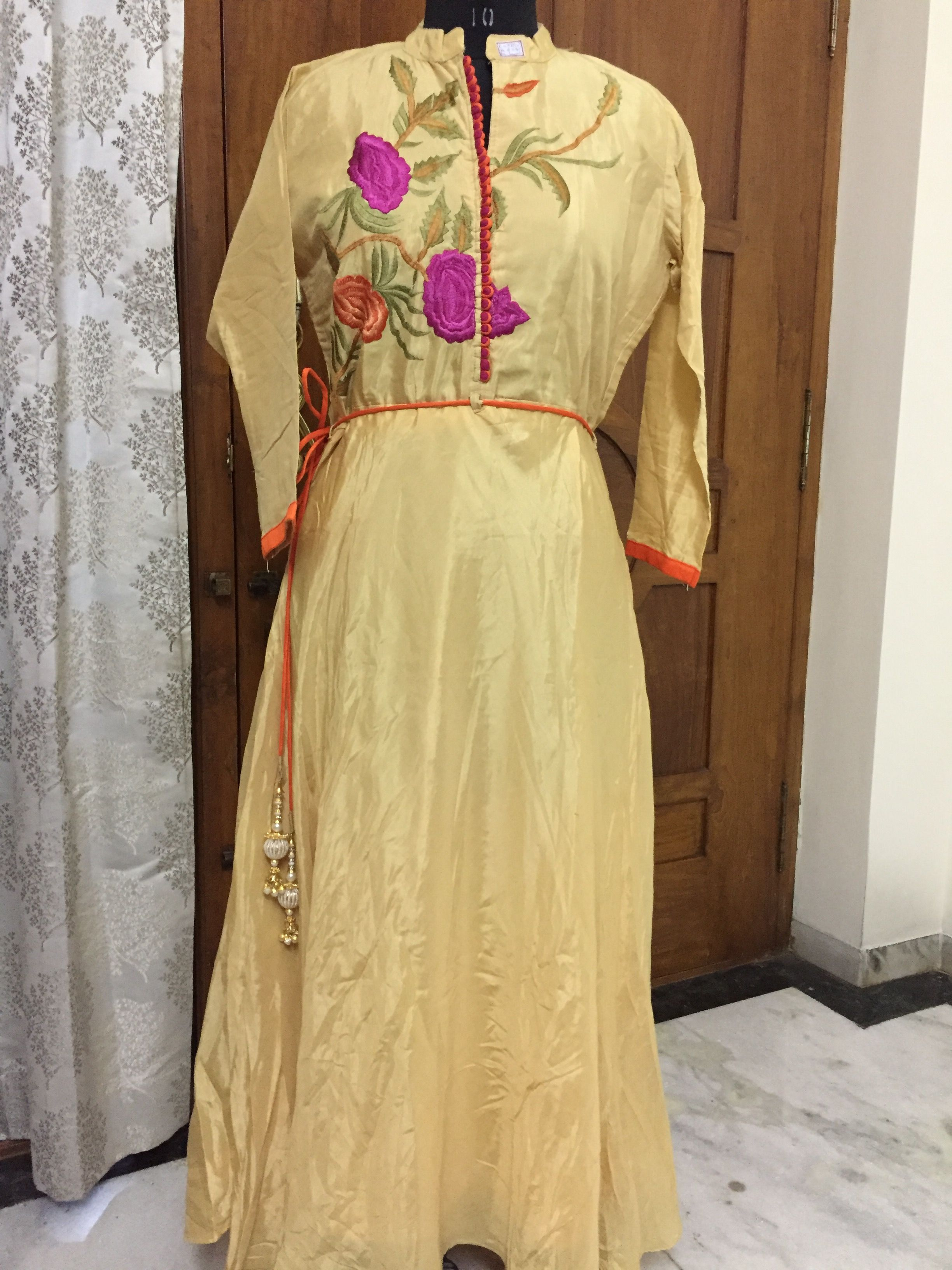 CODE: long kurti MATERIAL:yellow silk anarkali long kurta with floral embroidery on the yoke  PRICE:ping us for price TO BLOCK CALL OR WHATSAPP US ON +919618419046 or drop us a mail trendyweaves@gmail.com  #kurties #indowestern #readymade #designerkurties #trendy #trendyweaves https://www.facebook.com/trendyweaves/posts/1446132685419256:0