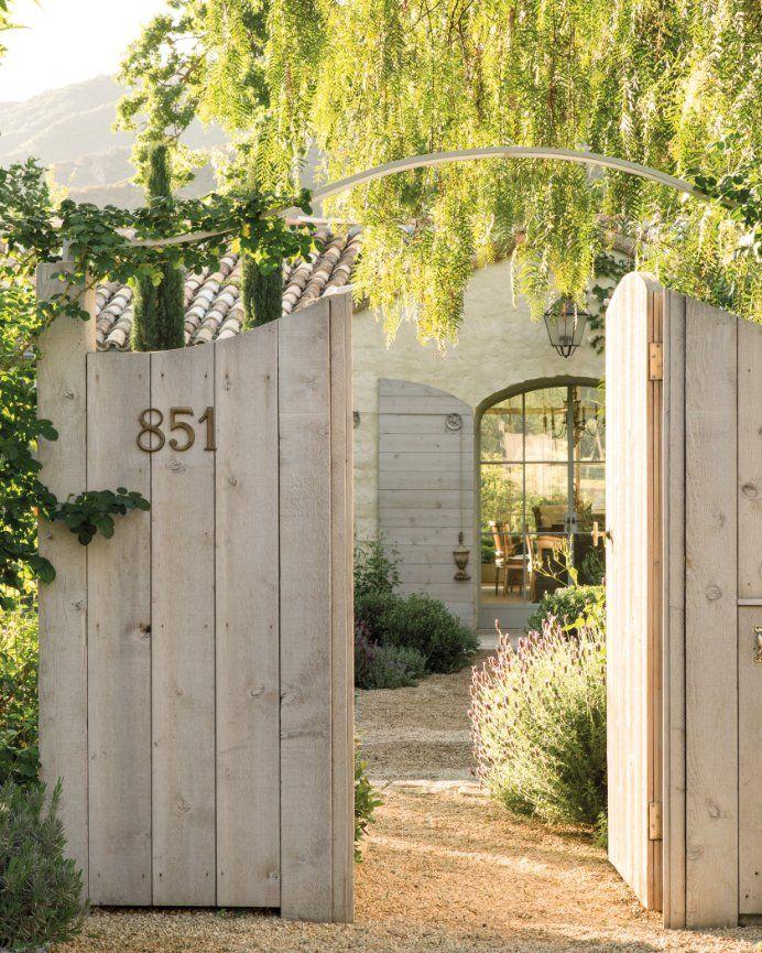 Garden gates at entry of Patina Farm by Giannetti Home. #garden #patinafarm #woodgates #giannettihome