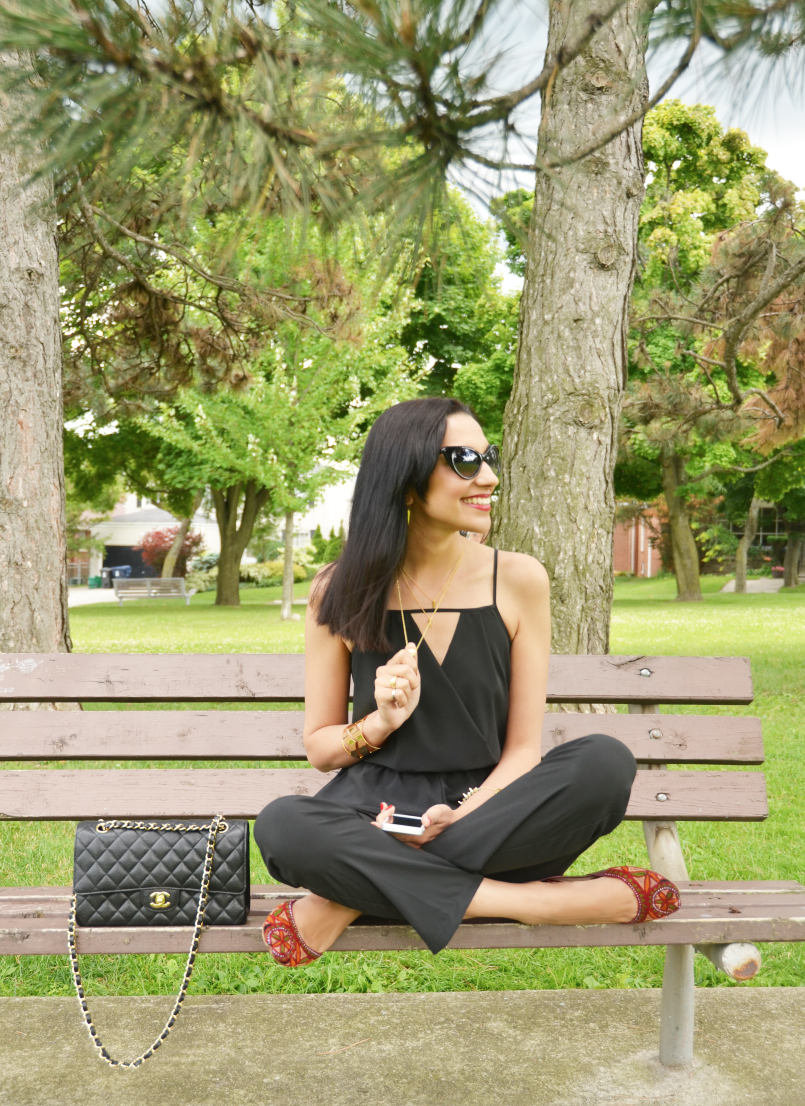 Black jumpsuit with traditional red shoes pop of red jumpsuit