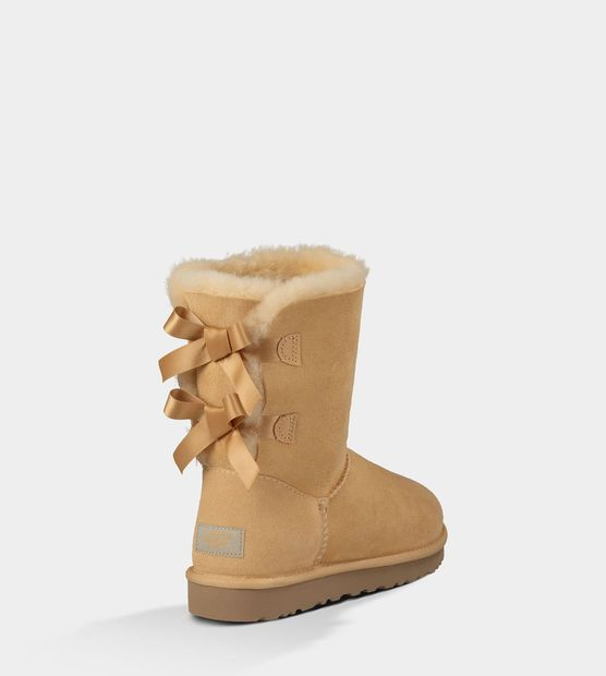 UGG™ Bailey Bow-Desert Sand WANT WANT WANT!!!!<3