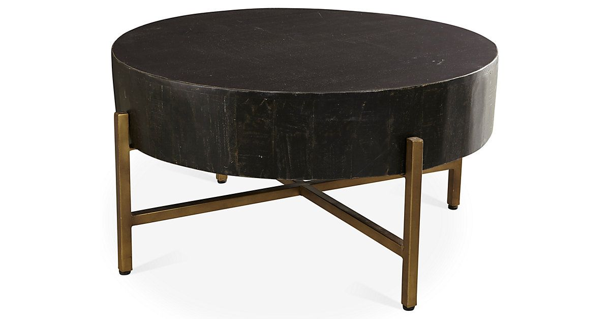 Supported By An Interlocking Br Base This Coffee Table Features A Round Mango Wood Top