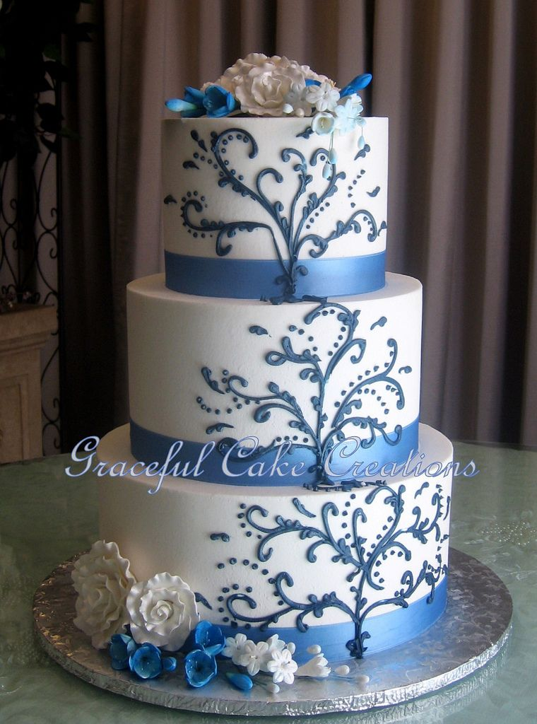 Elegant White Butter Cream Wedding Cake With Cornflower Blue