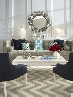A luxe living room. Using an eclectic mix of textiles and surfaces, this living room from the Jonathan Adler catalog beams with personality. The white walls and white coffee table allow for creative use of accessories.