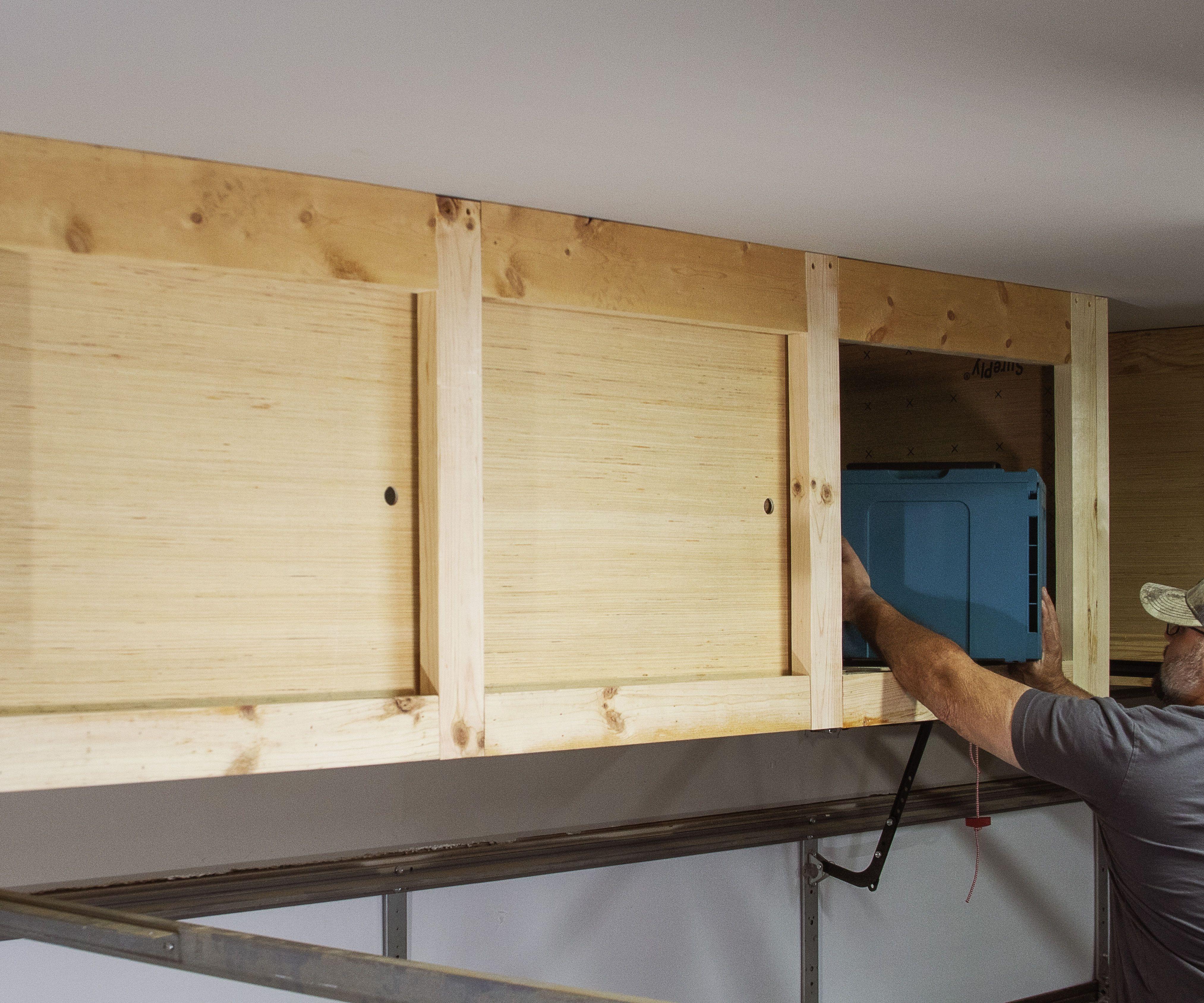 DIY Hanging Storage Shelves With Sliding Doors Overhead