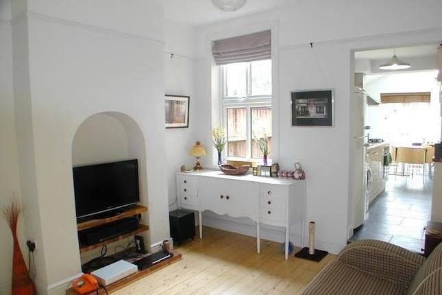 White washed room leading to kitchen extension