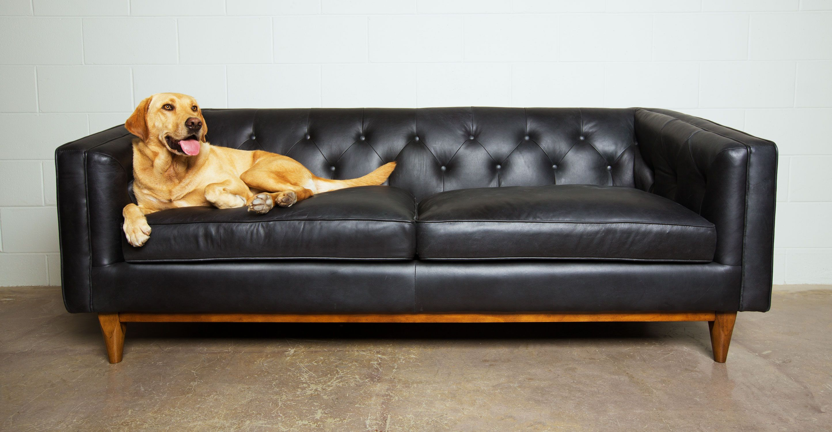 Black Leather Sofa In Walnut Wood Finish