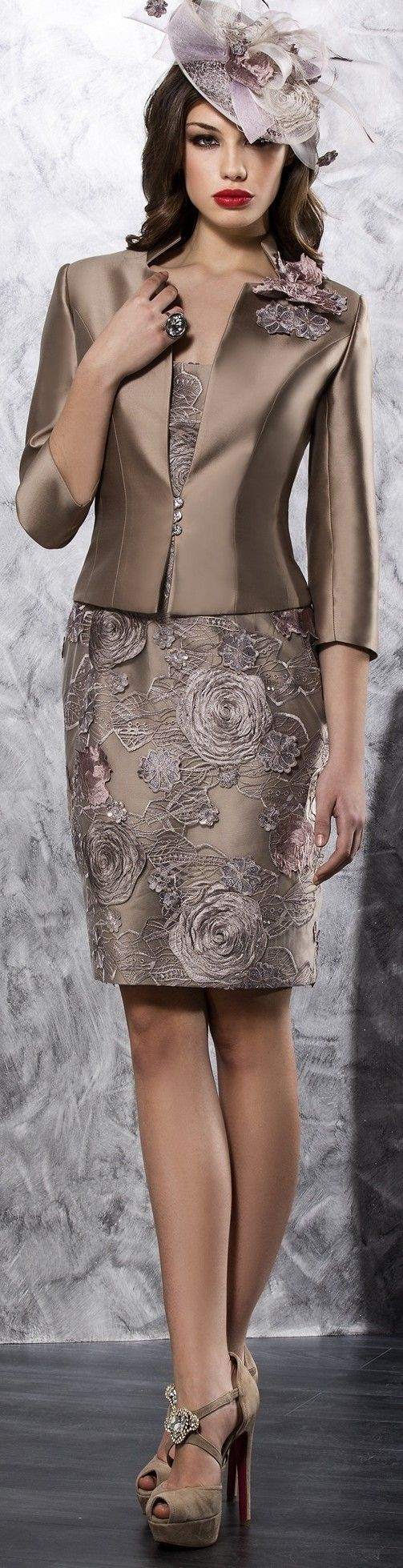 This short mother of the bride dress has embroidery embellishments on a short skirt.  The 3/4 sleeve jacket completes the ensemble.  Our #fashion firm provides custom mother of the bride attire for women all over the globe.  We can sketch the design or work from any picture you have.  See other mother of the bride dresses to work from at http://www.dariuscordell.com/product-category/mother-of-the-bride-dresses/:
