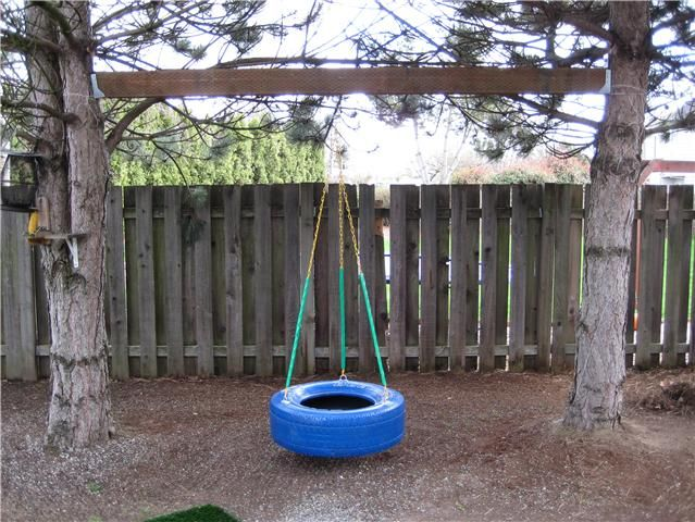 Tire Swing Between Two Trees Backyard Creations Kids Yard Backyard Play