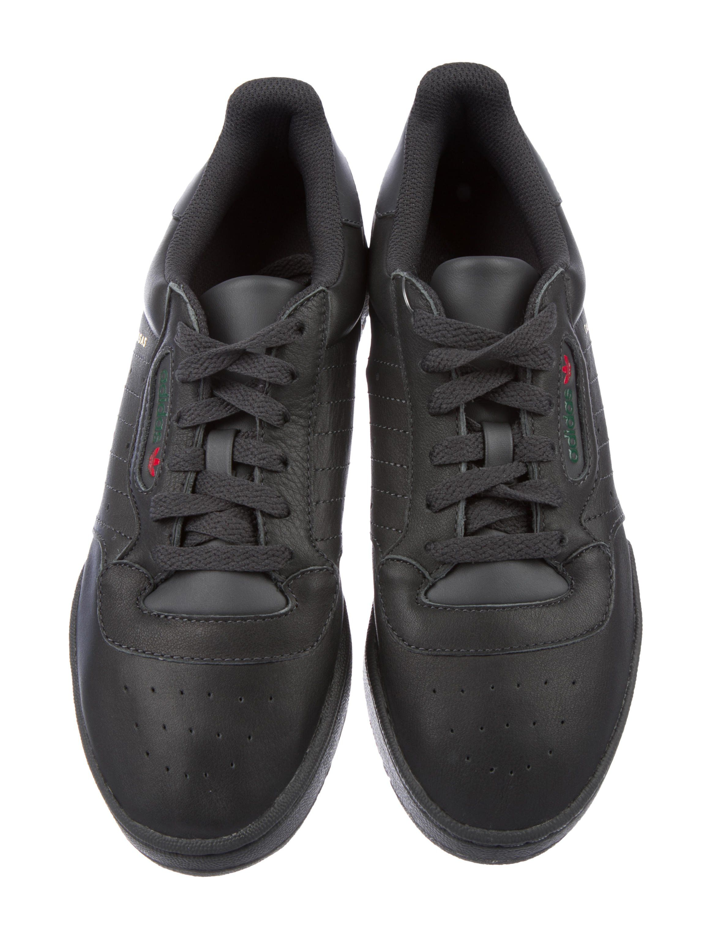 e15645eee4654 From the 2017 Release. Men s Core Black leather Adidas Yeezy Powerphase  Calabasas round-toe low-top sneakers with perforated accents