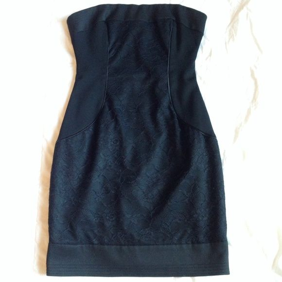 "Bebe Lace Inset Little Black Dress This little black dress is amazing. EUC. Only worn once, there is one loose thread in the back by the zipper shown in pic(not visible on, doesn't affect fit). Labeled size 4 but would fit a 2 or someone who is between a 2-4 best. Im 5'6"", 32DD, and 25-26 in jeans, for reference. This is a bit too snug in the bust for me. bebe Dresses Mini"