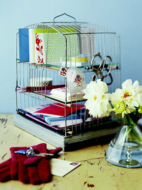 Bird cage turned mail center. Use dowels, cut slightly longer than the cage as shelves. Place glass or plexiglass over the dowels.