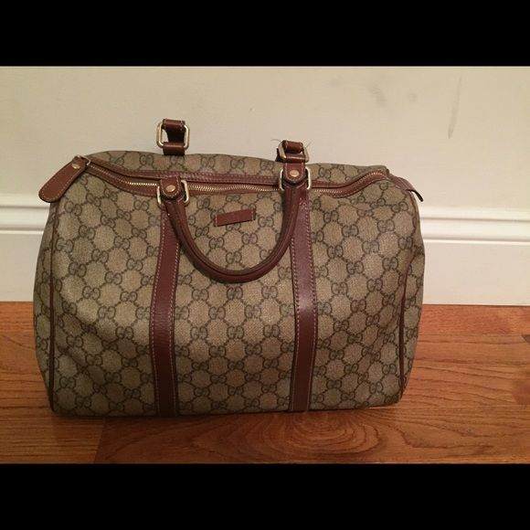 Gucci Boston bag! 100% authentic Gucci Boston bag! Great condition... Small signs of wear on handles and a spot of two inside but the outside of the bag is in great condition! Any questions please ask! Gucci Bags Satchels
