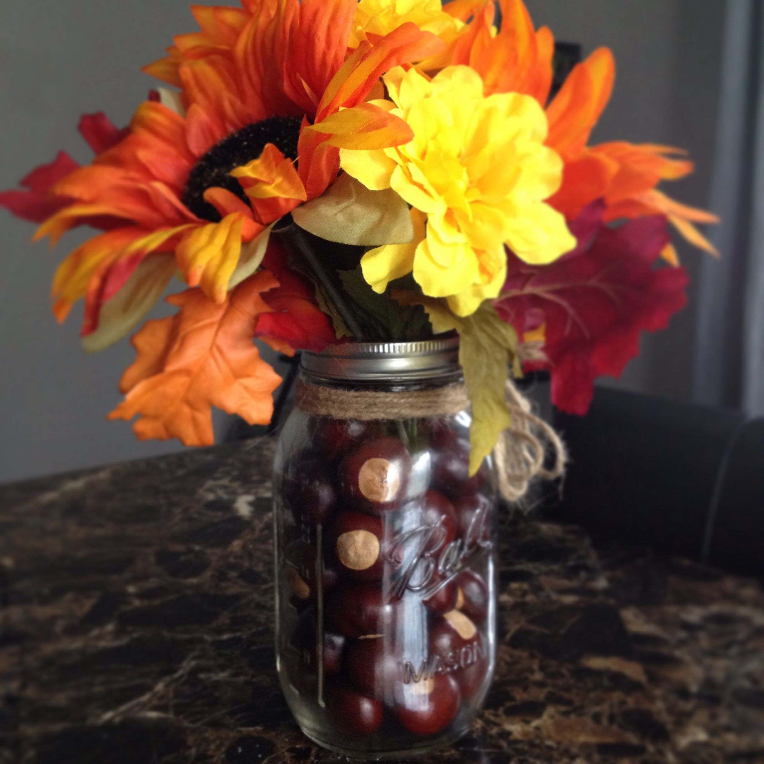 Flowers buckeyes mason jar ud fall centerpiece couldnut figure