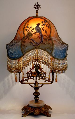 Ornate antique table lamp with original paint and wonderful amber ornate antique table lamp with original paint and wonderful amber prisms holds a custom chinoiserie bird lampshade dyed deep amber to dusty midnight blue aloadofball Choice Image