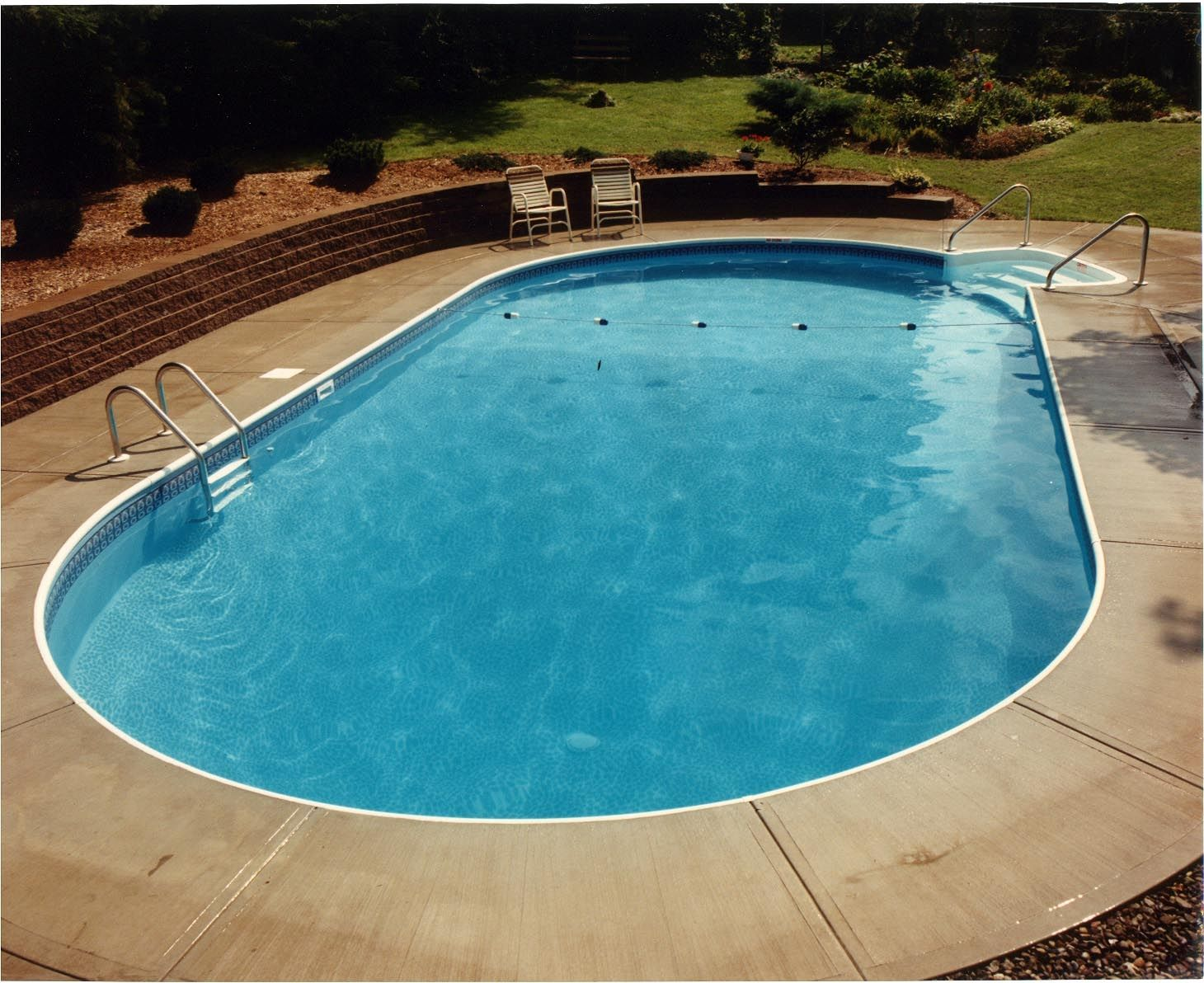 Oval swimming pool in ground swimming pools built by for Oval swimming pool