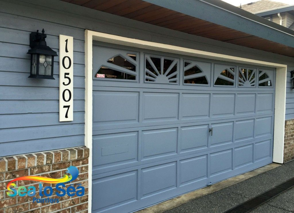 Solid Colour Garage Door With Sunburst Windows Painted With Diamond From Dulux Sea To Sea Painters Garage Doors Front Door Paint Companies