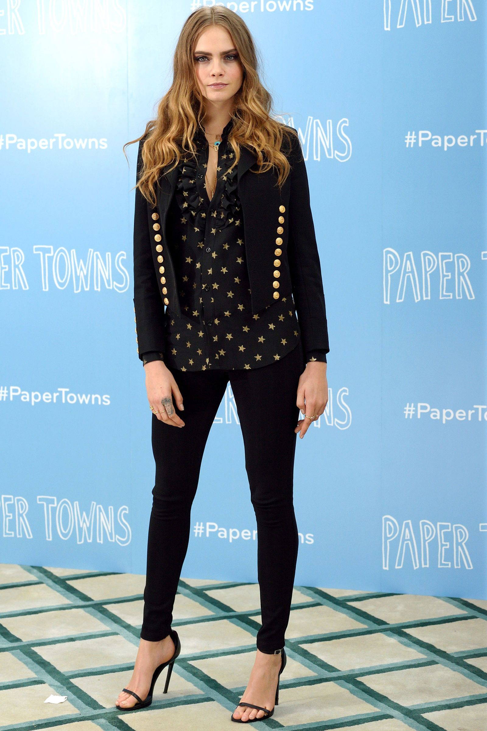 In Saint Laurent by Heidi Slimane at the Paper Towns photocall in London   - Seventeen.com CARA DELEVINGNE