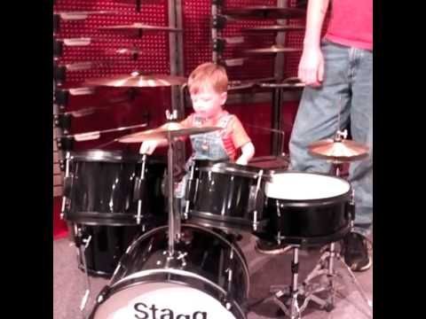 Baby plays drums