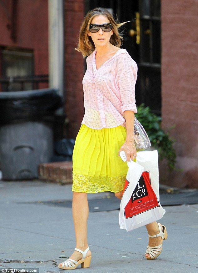 Striking: Sarah Jessica Parker was a bright sight in her banana-yellow skirt and pale pink blouse on a solo Saturday shopping spree