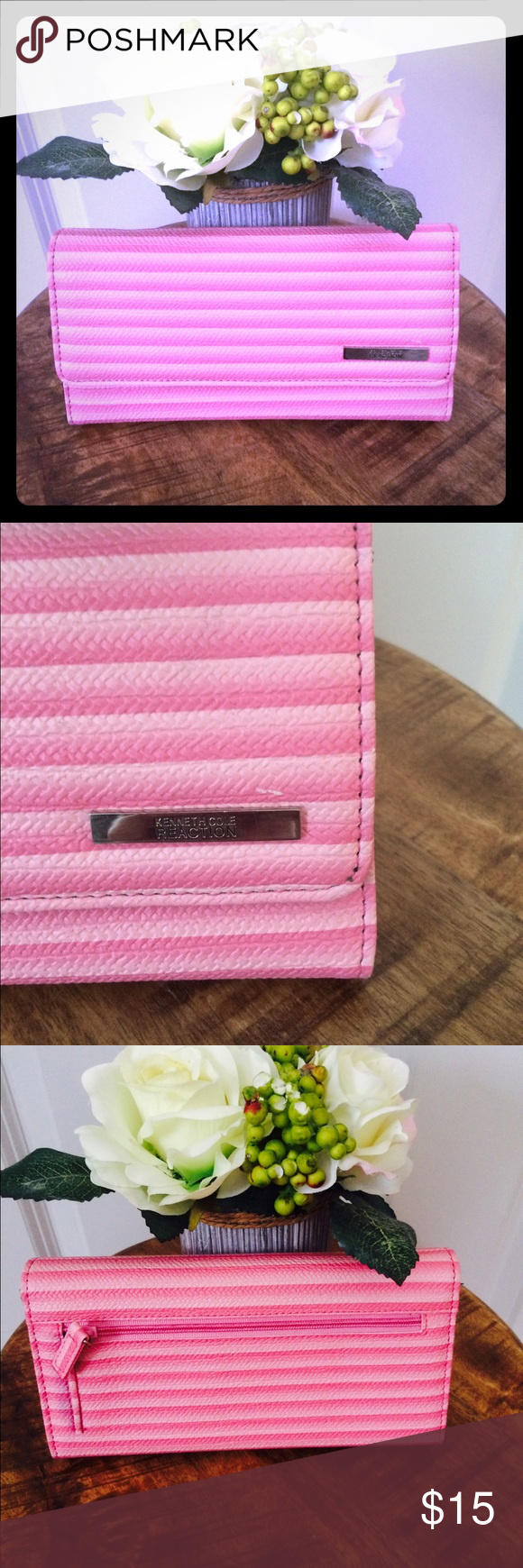 Kenneth Cole Reaction Pink Wallet Kenneth Cole Reaction Pink Stripped Wallet with black interior! Never used before! Just has one little mark on wallet which is shown in picture along with one tiny scrap on silver logo!  In good condition! Inside of wallet has multiple slots and pockets and chain pocket in back of wallet! Message me with any questions! ❤️ Kenneth Cole Reaction Bags Wallets