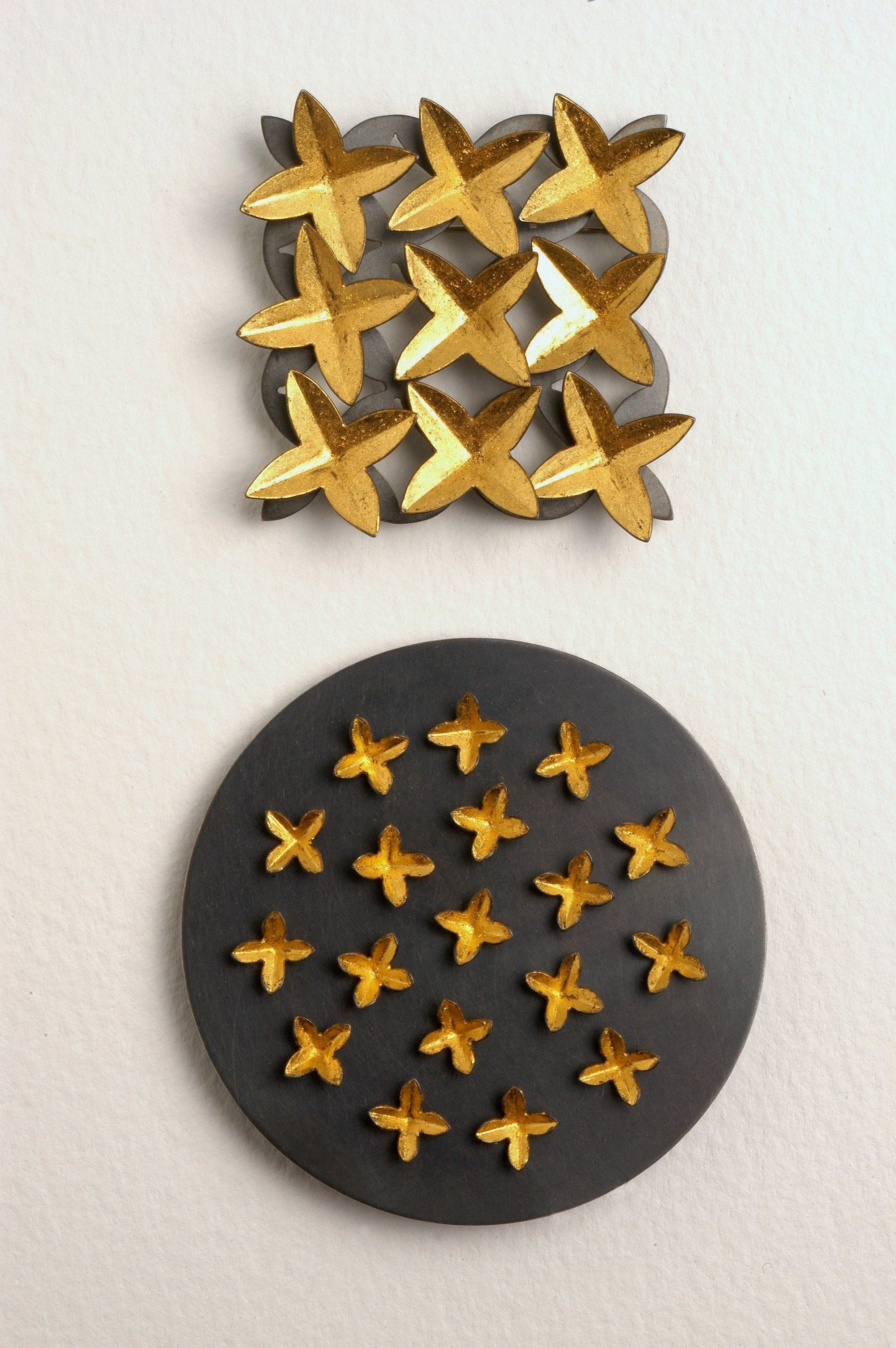 Rich gold and black brooches by Anna Gordon Contemporary