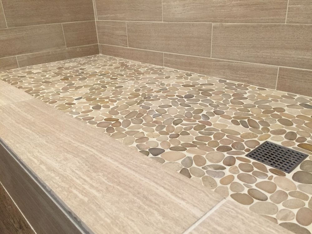 Sliced java tan pebble tile shower floor. https//www