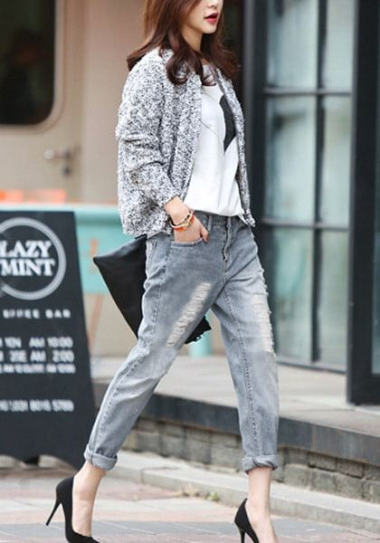 Full right of model in distressed grey washed boyfriend jeans ...