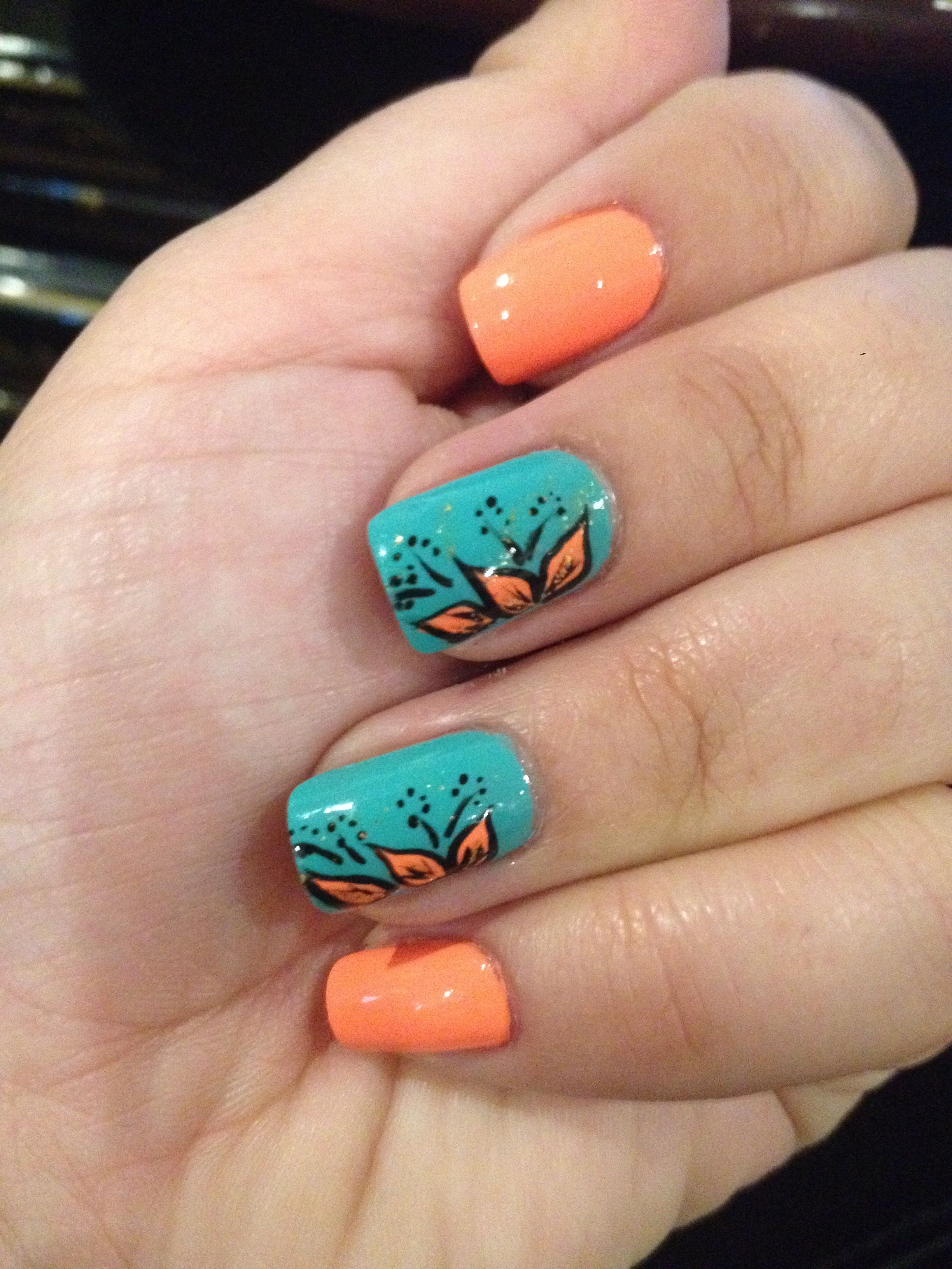 Really liking the two nails different colors with designs.