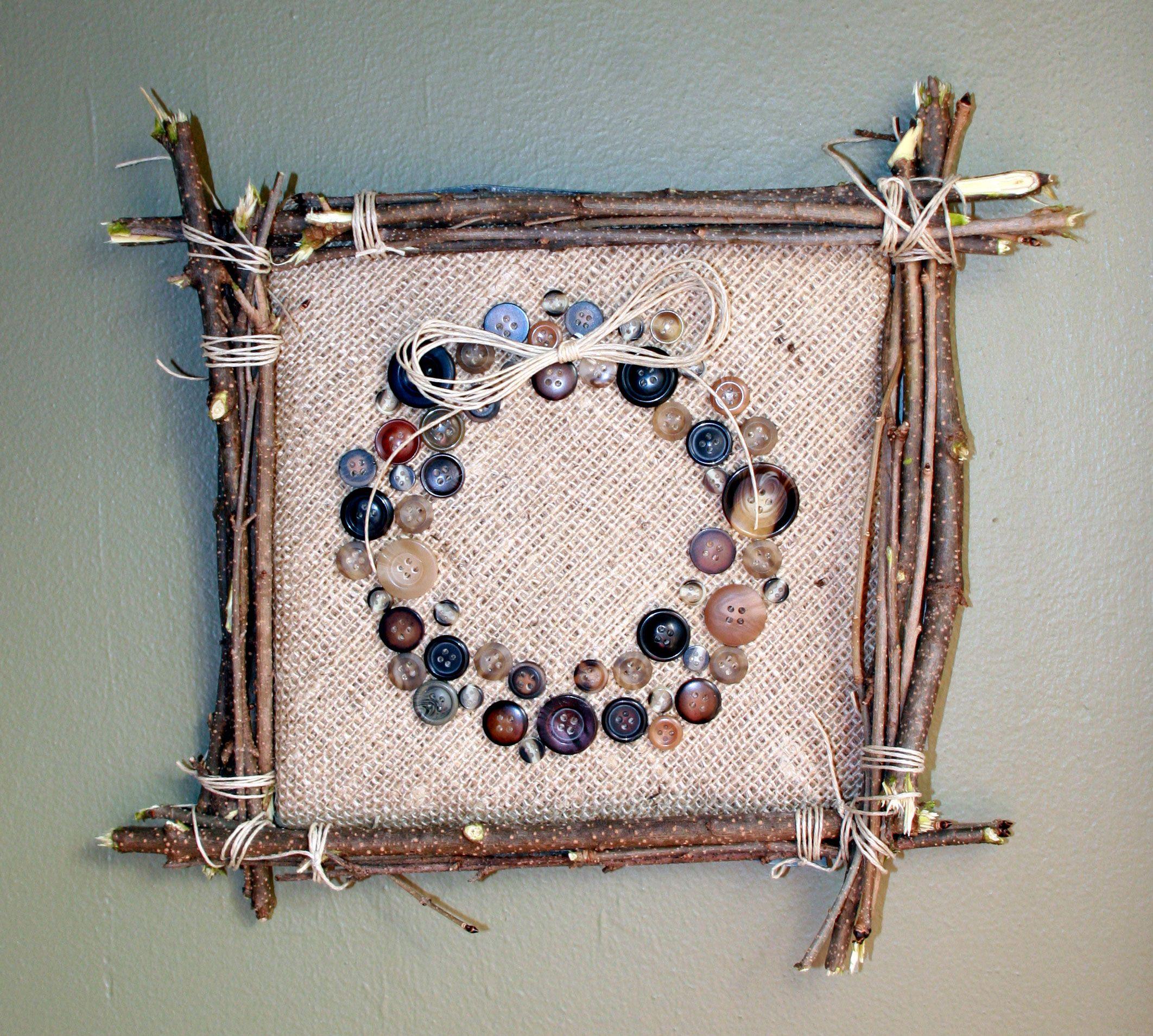 DIY rustic twig frame burlap jute fabric background over cardboard