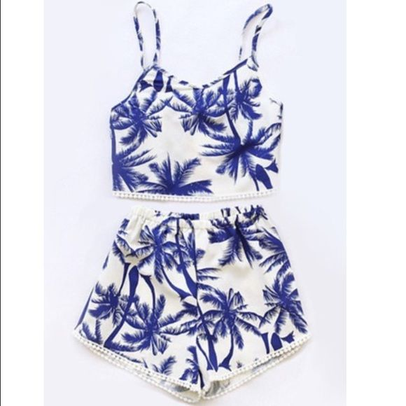 eac0d20d941 2 piece swim suit! Cropped top with shorts!! Great swim suit with cropped  top and shorts! Great for vacation or just swimming!!! Is blue and white  with palm ...