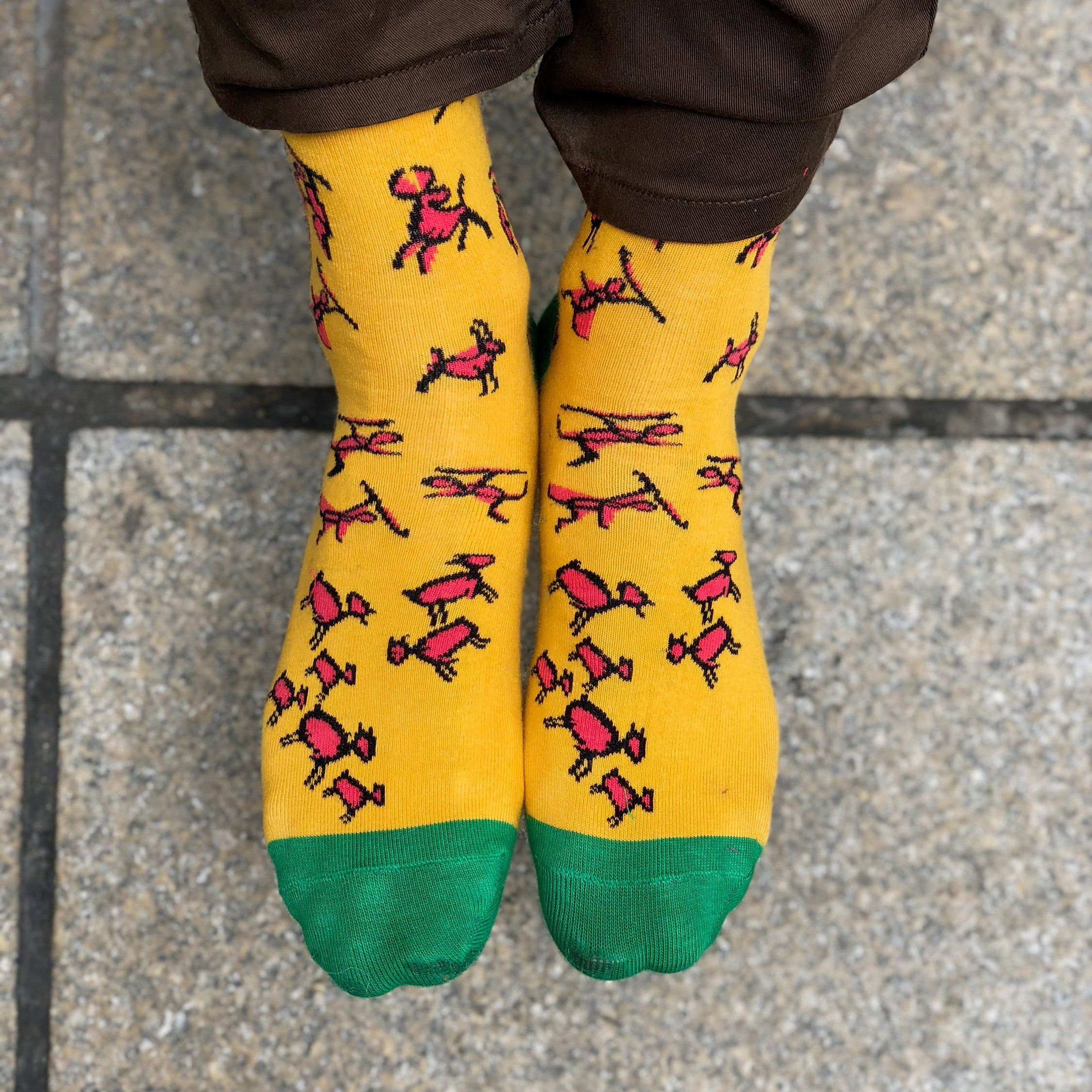 e6b88255b5af Supper funny stone age art!. Yellow colorful socks with cave men drawings  on it. Super fun gift for men for any kind occasion.