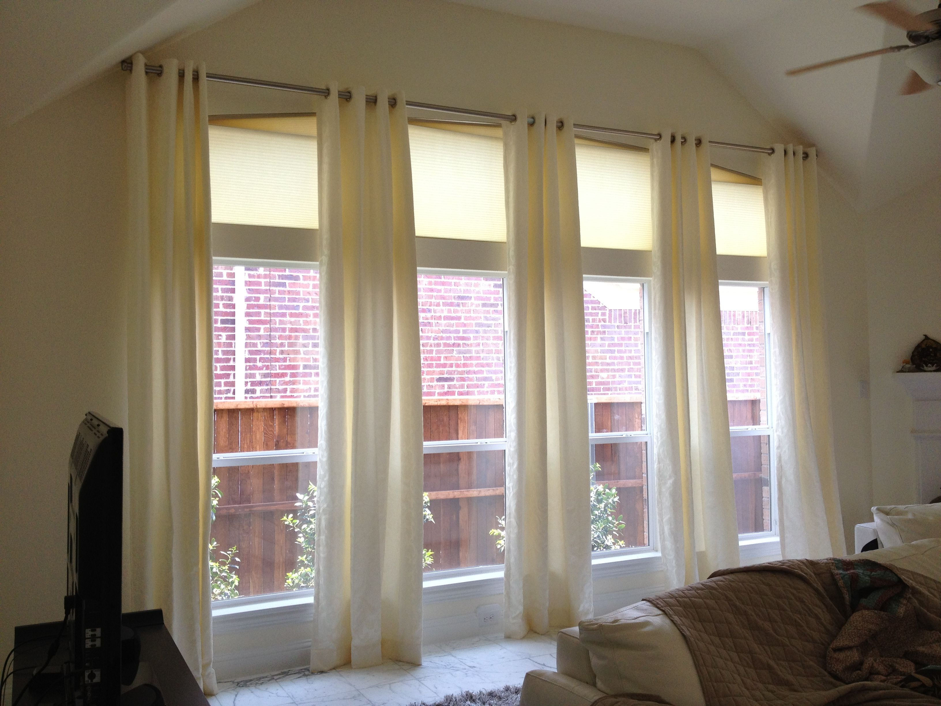 Grommet Paneled Drapes Bring Warmth To These Windows