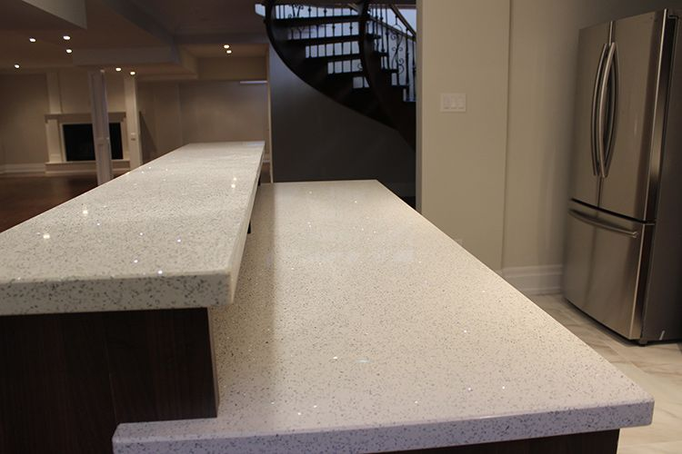 Two Level Kitchen Bar With White Double Edge Quartz Countertop