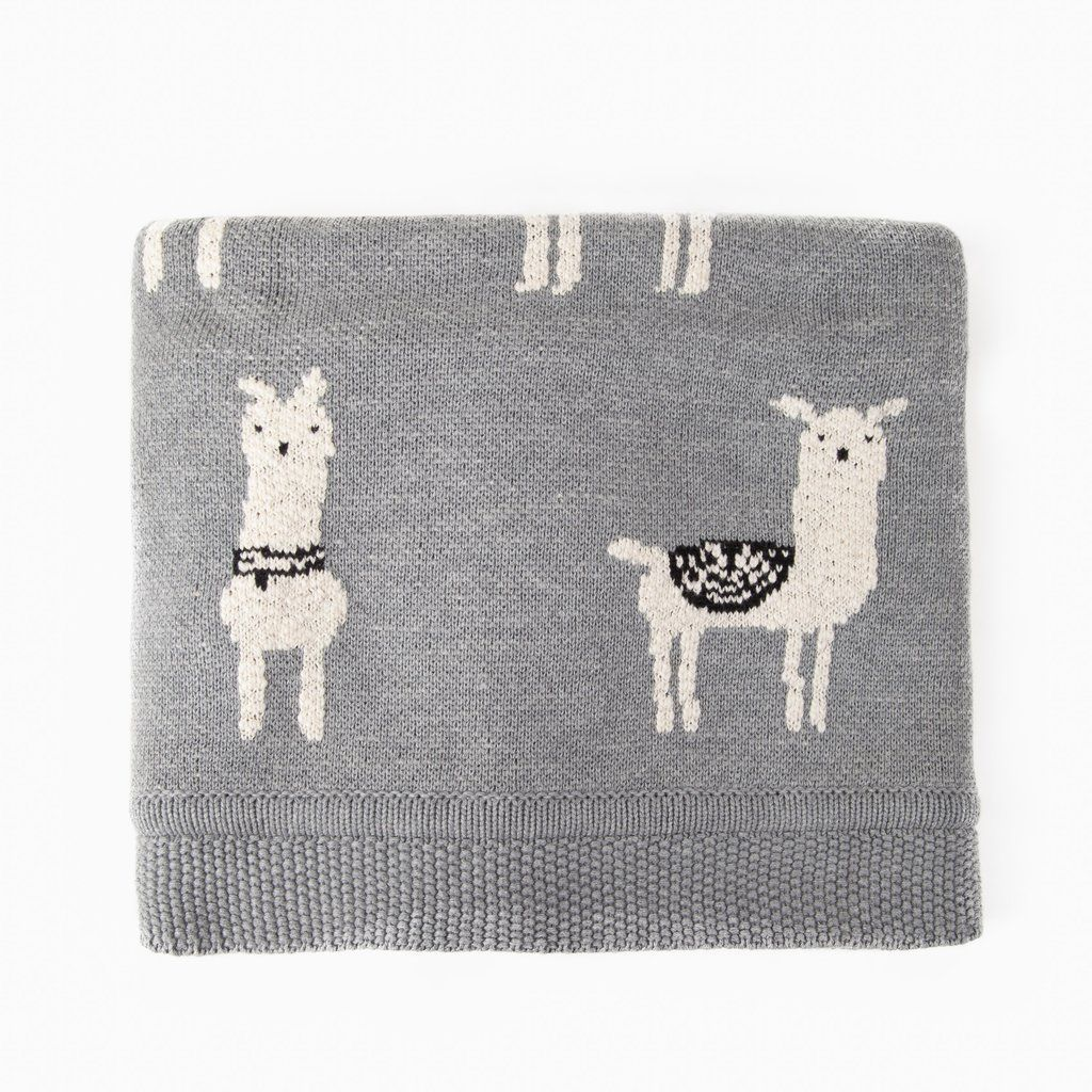 A Herd Of White Llamas Graze Against A Blueish Grey Background In This 100 Cotton Knit Throw Blanket Knit Throw Blanket Knitted Throws Organic Cotton Blanket