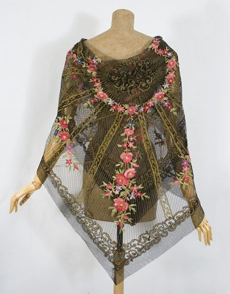 this is tambour embroidery which takes a long time to do. it is a stunning piece of work.