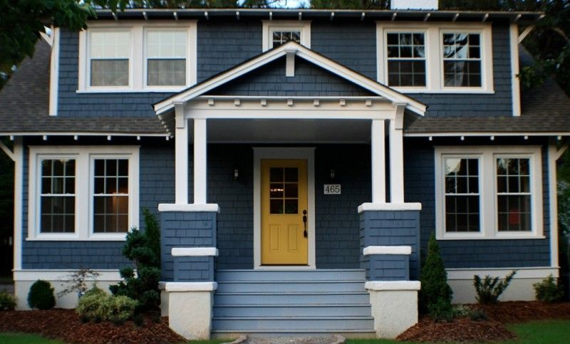 Decoration Brick Wall Using Navy Color Paint For Home Exterior With Yellow Door And White Win House Exterior Blue Exterior House Colors Home Exterior Makeover