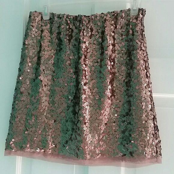 Lauren Conrad sequined mini skirt Lauren Conrad sequined mini skirt. It's a rose gold color. Size small. 100% polyester she'll and lining. Lauren Conrad Skirts Mini