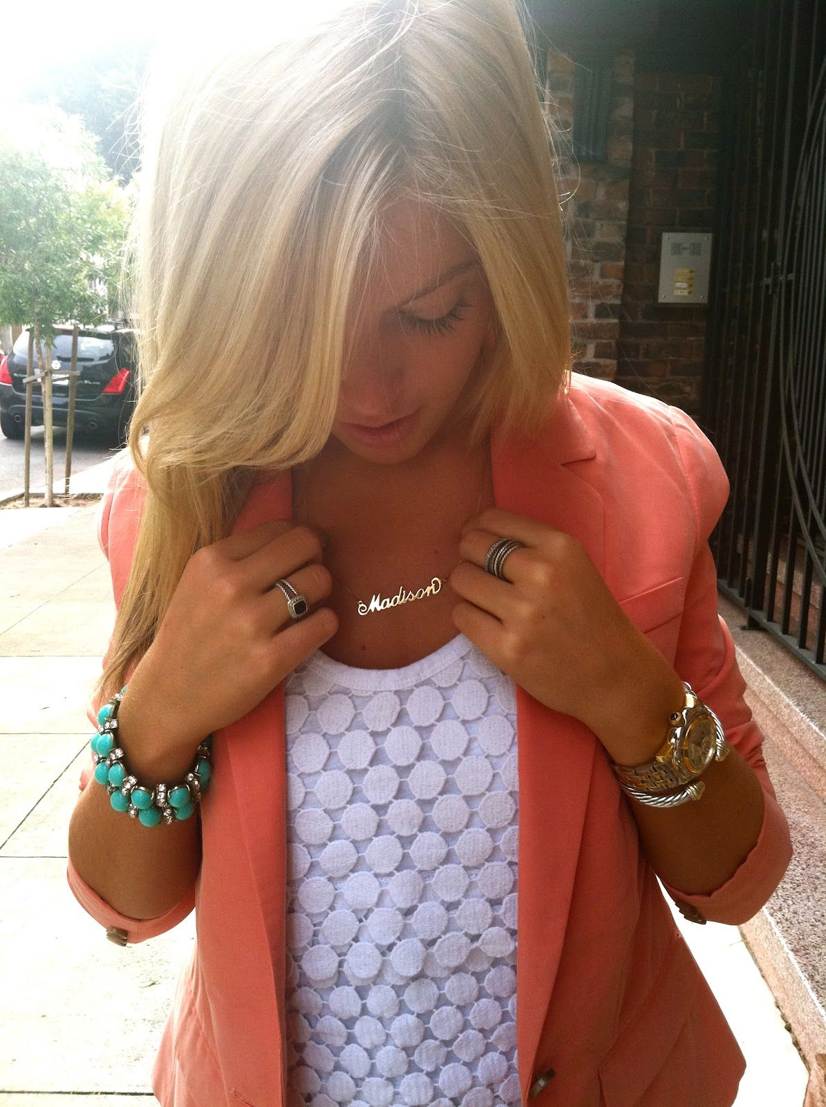 coral blazer, white lace, turquoise.