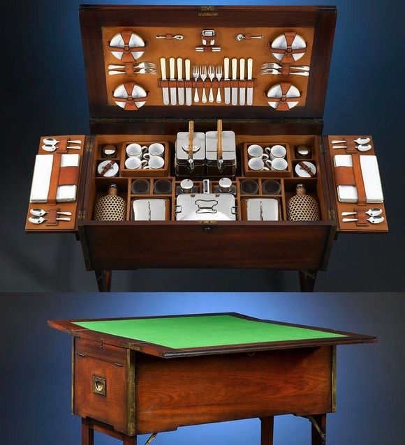 A stunning expanding English mahogany picnic chest and games table is being offered for sale by M.S. Rau Antiques of New Orleans. The exquisite piece, made circa 1920, resembles a simple wooden trunk at first glance; with its four legs unfolded however, the top and sides open out to reveal a complete luncheon service for eight, including Sheffield silverplate utensils, bone-handled cutlery, plates and saucers, cups and glasses, kettles and burners for hot water and soup, single and stacked…
