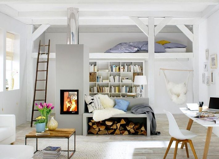 masonry heater in this Swedish looking small living space with loft.