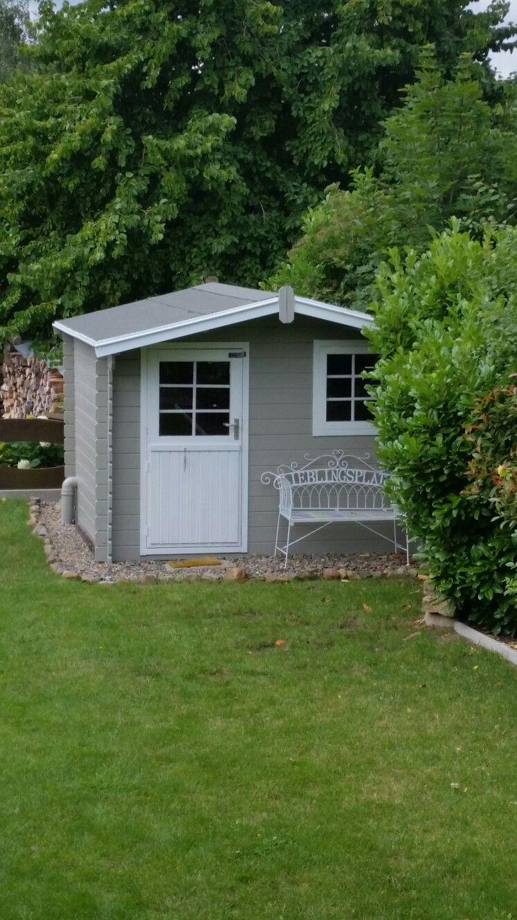 Gartenhaus grau weiß.