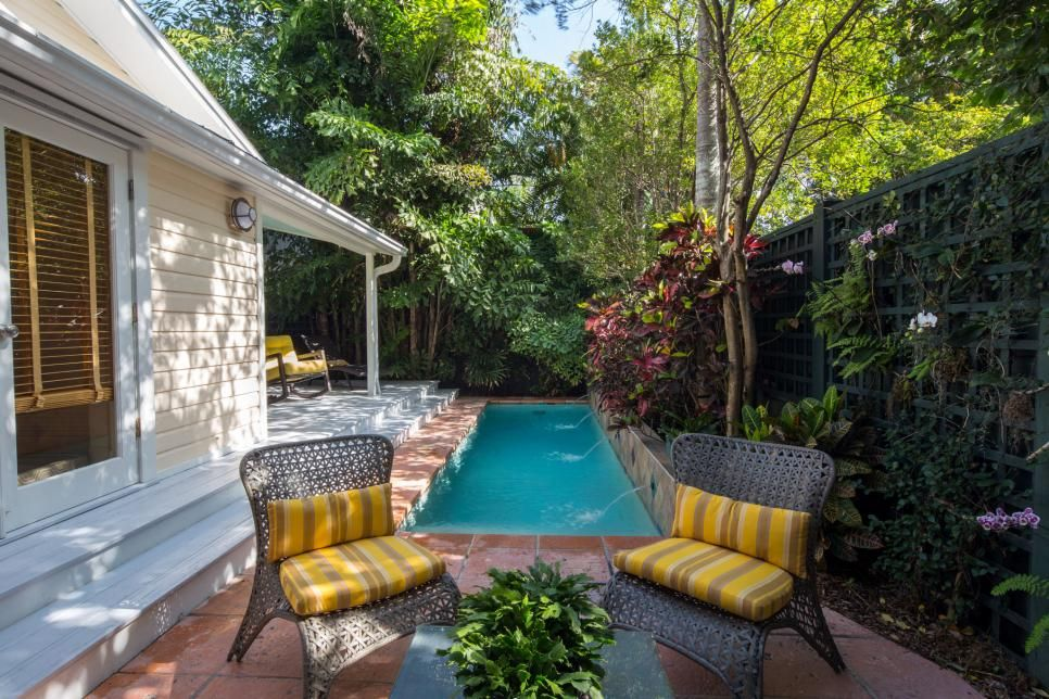 There is something both intimate and luxurious in this exquisite layout by Carl Gilley Landscape Design that incorporates a patio, lap pool and veranda into an idyllic outdoor living space on a side yard.