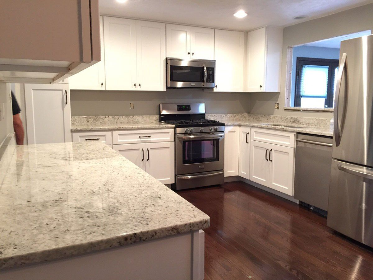 Small White Kitchen With Colonial White Granite Countertops Kitchen Remodel Countertops White Granite Countertops Cheap Kitchen Remodel