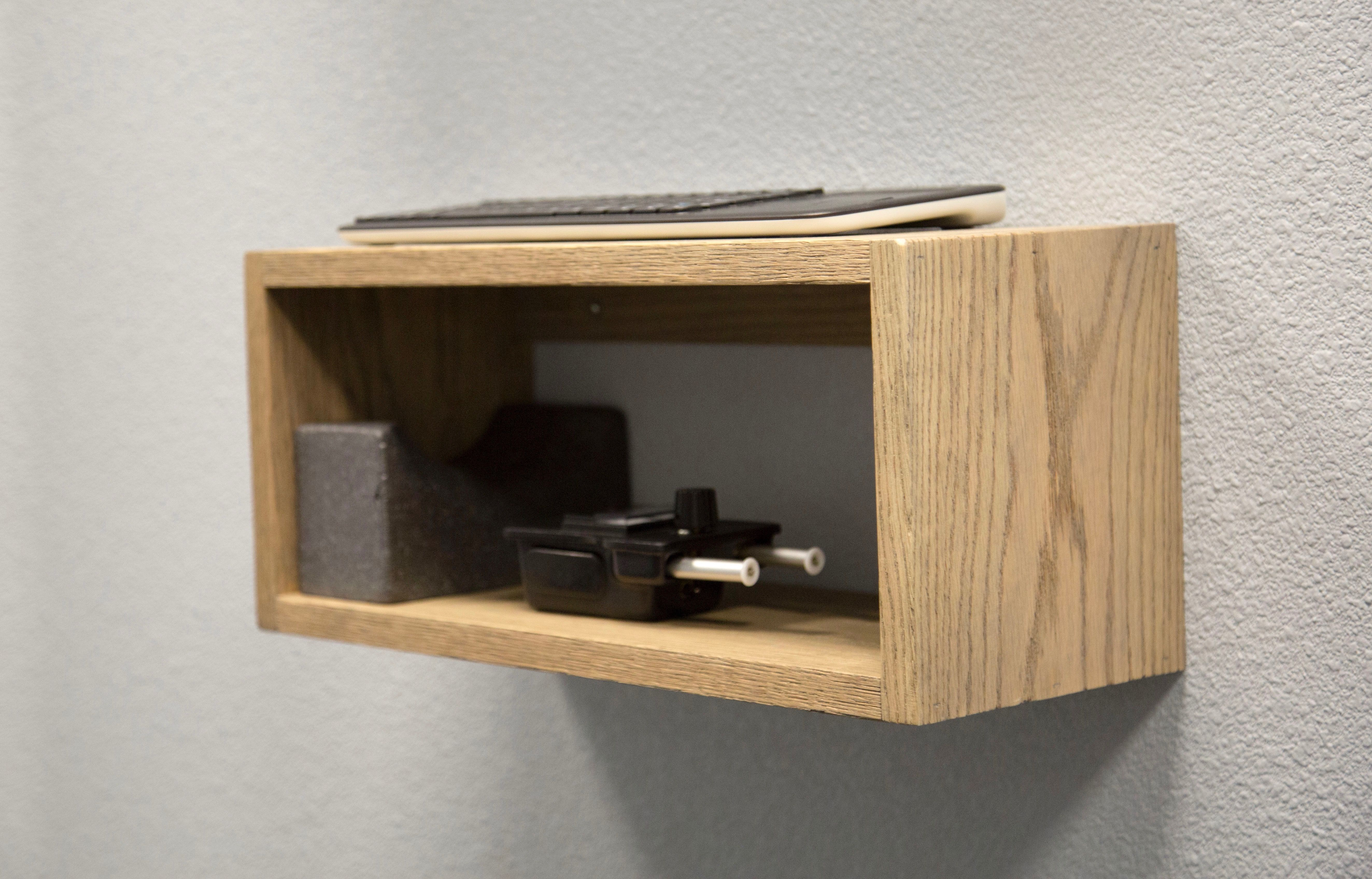 The multi-functional modern box on the wall under the touch AIO computer holds…