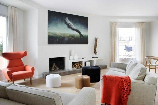 tableau art contemporain qui orne les murs blancs dans le salon aux accents rouges